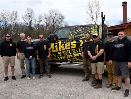 Some of the employee's of Mike's Roofing. The business was started by Mike Cullop and does residential and commercial roofing, siding, windows and pole barns.