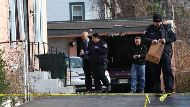 Police at the home at the center of the alleged abduction on Harvest Street on Dec. 8, 2015.