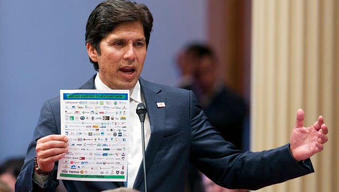 In this July 17, 2017, file photo, Sen. President Pro Tem Kevin de Leon, D-Los Angeles, displays a list of various backers of a climate change bill in Sacramento. Democrat Kevin de Leon, president of California State Senate, announced Sunday he will challenge Sen. Dianne Feinstein in next year's election. (AP Photo/Rich Pedroncelli, File)