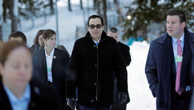 Treasury Secretary Steven Mnuchin walks through the snow during the annual meeting of the World Economic Forum in Davos, Switzerland, on Jan. 24, 2018.