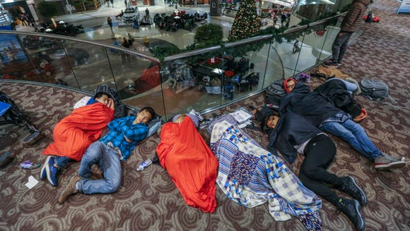 Travelers sleep in the atrium at Hartsfield-Jackson