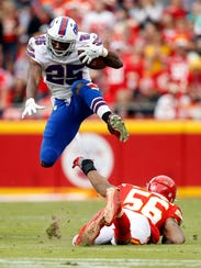 Buffalo Bills running back LeSean McCoy leaps over Kansas City linebacker Derrick Johnson during Sunday's game in Kansas City. Jamie Squire/Getty Images