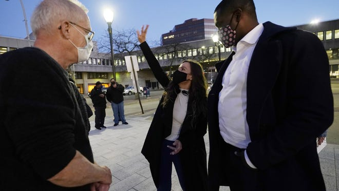 New York State Senator Alessandra Biaggi, center, speaks as U.S. Representative-elect Mondaire Jones, D-N.Y., right, and a supporter, left, listen after Jones spoke at a Protect the Results rally, Wednesday, Nov. 4, 2020, in front of the Westchester County Courthouse in White Plains, N.Y. Jones and Ritchie Torres will become the first openly-gay Black members of Congress in January when they are sworn into the House of Representatives.