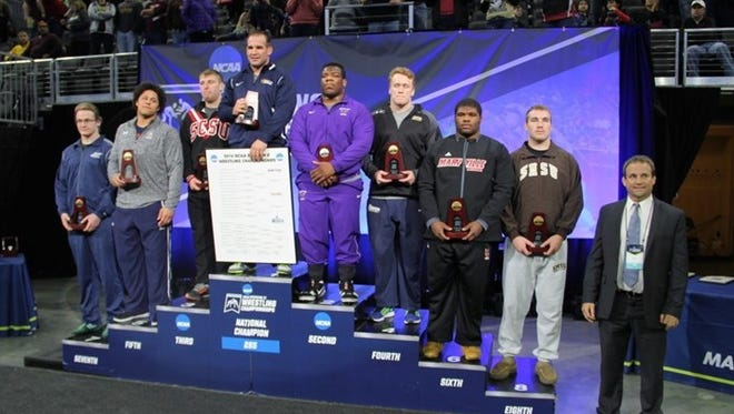 Minnesota State redshirt senior and New Rochelle native Malcolm Allen (fifth from the left) finished second in the NCAA Division-II Wrestling Championships on Saturday, March 12th, 2016.