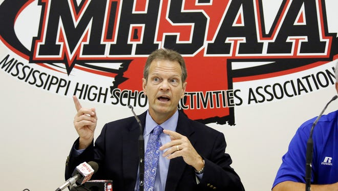 Mississippi High School Activities Association Executive Director Don Hinton addresses venue changes for state public high school football finals during a news conference today at association headquarters in Clinton. Hinton said the football championships will move from Jackson, and will be played at Mississippi State's Davis Wade Stadium in Starkville in 2014 and 2016 and Ole Miss' Vaught-Hemingway Stadium in Oxford in 2015 and 2017. Additionally, Southern Mississippi will host the Mississippi/Alabama Football Classic in 2015 and 2017 in Hattiesburg. It will be the first time in the event's 27-year history that the game will be played in Mississippi. (AP Photo/Rogelio V. Solis)