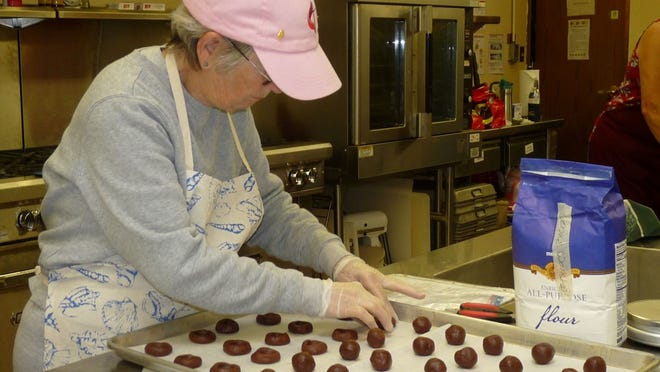 Janet Hardenburg makes cookies for last year's First United Methodist Church Holiday Bazaar.