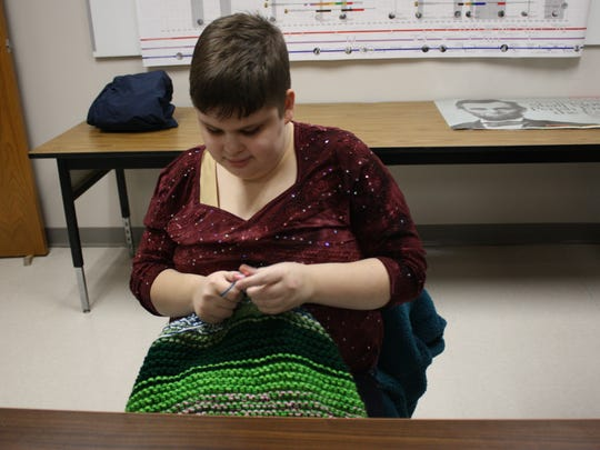 Aspen Poole, a 19-year-old senior at Vestal High School, is blind, has OCD and is on the Autism spectrum. Knitting helps her focus, and several of her teachers allow her to knit during class.