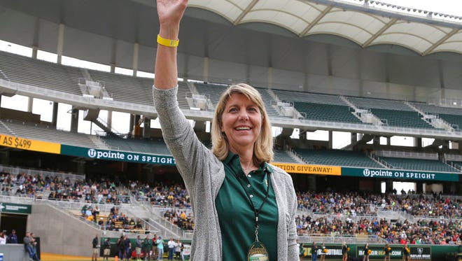 "FILE - In this April 22, 2017, file photo, Baylor's new president Linda A. Livingstone waves to the fans as she is introduced during the first half of the NCAA college football team's Green and Gold spring game, in Waco, Texas. Baylor University settled a federal lawsuit filed by a former student who said she was gang raped by two football players and alleged the program at the nation's largest Baptist school fostered a ""culture of violence."" Details of the settlement announced Tuesday were not disclosed. The woman's attorney, John Clune, said the deal was reached within the last week. Clune credited new Baylor President Linda Livingstone with pushing Baylor to address the lawsuits and how it can improve its response to sexual assault in the future.  (Jerry Larson/Waco Tribune Herald via AP, File)"