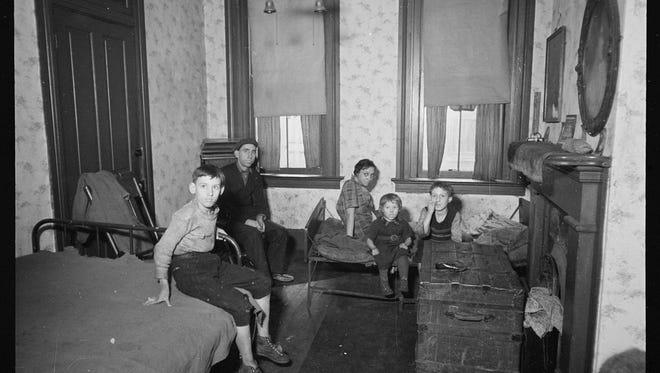 Tenement bedroom and kitchen, Hamilton County, Ohio, 1935