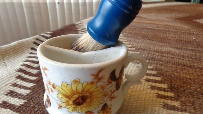 Shaving mugs are divided, with one side for water and brush and the other for soap.
