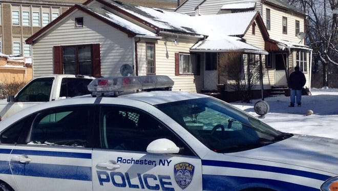 Police investigate a stabbing on Parkway in Rochester on Friday.