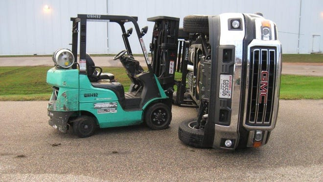 Authorities say two teens used a forklift to flip a pick-up truck during their vandalism spree.