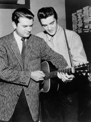 "Sam Phillips and Elvis Presley on Dec. 4, 1956, when Elvis dropped by Phillips' studio and joined Johnny Cash, Carl Perkins and Jerry Lee Lewis for an impromptu jam that would become known as ""The Million Dollar Quartet"" session."