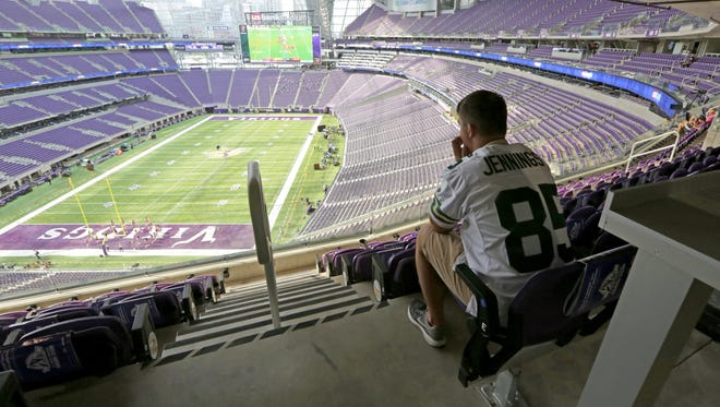 PACKERS - A lone Packers fan sits in the stands of the new $1.1 billion U.S. Bank Stadium, in Minneapolis before the game against the Green Bay Packers and Minnesota Vikings on Sunday, September 18, 2016 at U.S. Bank Stadium, in Minneapolis, Minn.- Photo by Mike De Sisti /MDESISTI@JOURNALSENTINEL.COM
