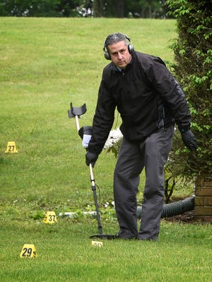 Lebanon County detectives use a metal detector to search for shell casings at 2000 Weavertown Road in North Lebanon Township Tuesday morning, May 30.