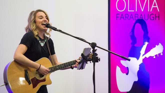 Local singer/songwriter Olivia Farabaugh performs at a recent show at Snitz Creek Brewery's tasting room in Campbelltown on Thursday, Nov. 17, 2016.