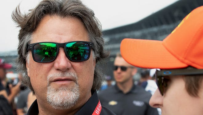 Team owner Micheal Andretti talks with his driver Zach Beach before the driver's meeting Saturday morning at the Indianapolis Motor Speedway. 5/26Gary Mook/ for the Star