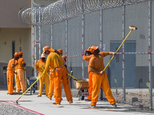 Inmates work inside the prison.