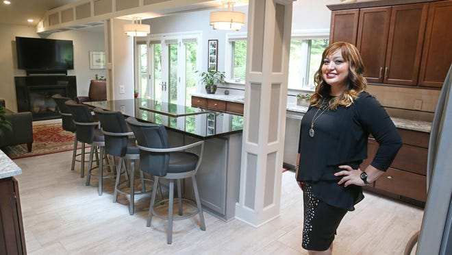 Selma Hammer, owner operator of Selma Hammer Designs, stands in the kitchen she completely redesigned in a home in Pittsford Monday, July 11, 2016.