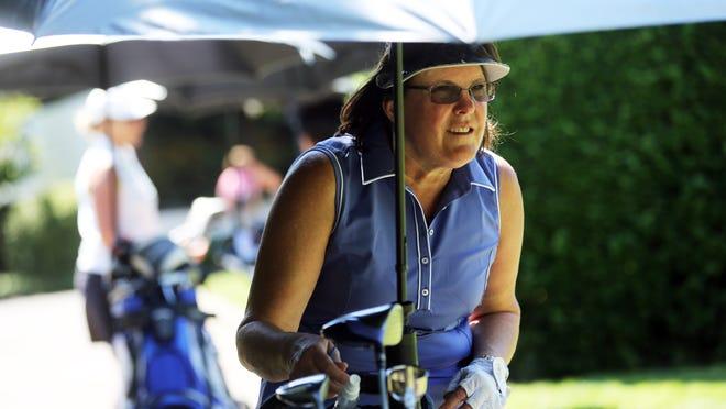 Connie Parker watches a friend's drive on a beautiful Saturday at Salem Golf Club.