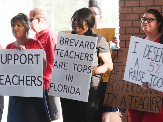 Teachers picket in front of School Board headquarters in Viera in 2018. Teachers were protesting the School Board's offer of a raise in pay.