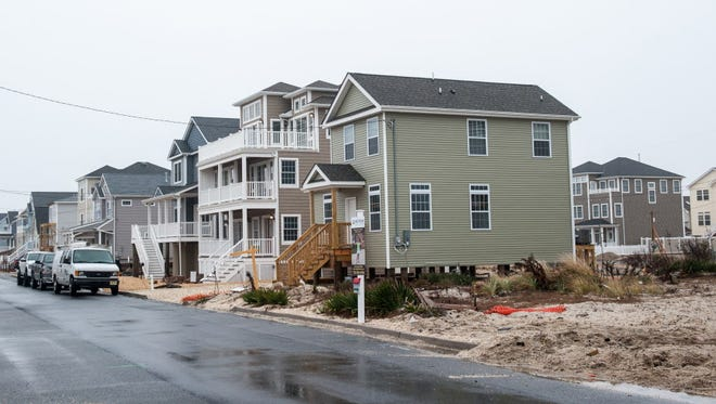 Bill Mullen is finally going to be moving into his rebuilt home (house closest to camera) in Ortley Beach, NJ. His original home at 18 Coolidge Ave was destroyed by Superstorm Sandy. Photo was taken on Wednesday, December 23, 2015.