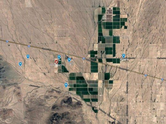 The Arizona Department of Environmental Quality selected 13 sites for its monitoring project related to air-quality complaints around Hickman's Egg Farms. Six out of the 13 sites were in Tonopah (shown in blue on the picture). The sites were between 650 feet and 4.5 miles from Hickman's operations (shown in red).