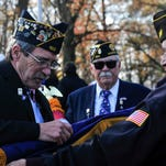 Veterans retire the colors following the Veterans Day Ceremony held at Veterans Park on Wednesday.