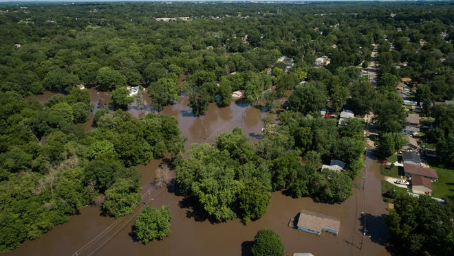 Flood waters spill over Four Mile Creek on July 1, 2018.