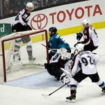 Schlemko's OT goal leads Sharks past Avalanche 3-2