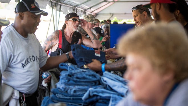 Veterans get help in the form of clothing, grocery and contact with social services at a past Stand Down event at Muncie Mission.