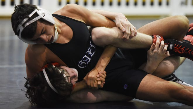 St. Mary graduated two key members of an already small wrestling roster, including Region 4 qualifier Thomas Cruz (top). The Gaels will not field a team this winter.