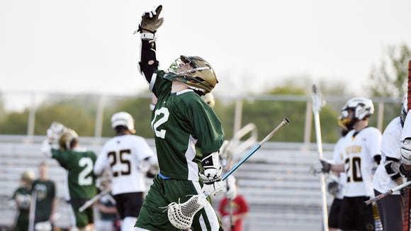 York Catholic's Liam O'Connor reacts after a teammate's goal in the first half of the YAIAA boys lacrosse championship game Thursday, May 12, 2016, at Central York. York Catholic defeated Red Lion 16-10 for the title.