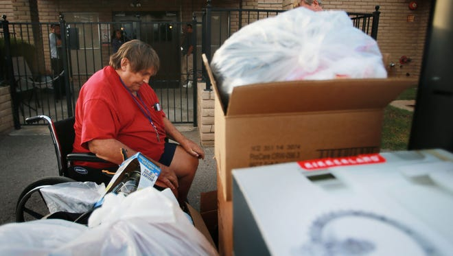 James Paternoster, who had been a resident of the Oasis Nursing and Rehabilitation Center, sits dejectedly with his belongings outside the center Thursday. Paternoster was apparently evicted Thursday and his belongings were left outside the building.