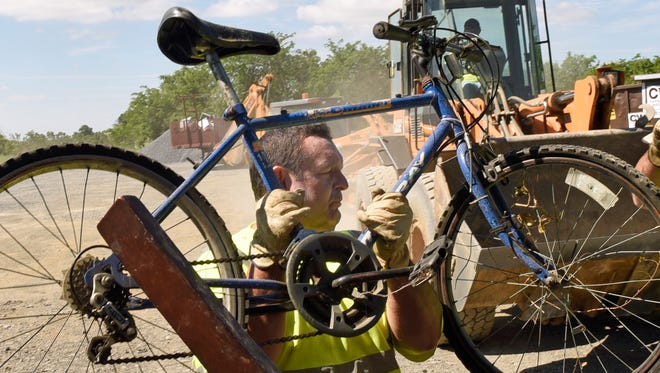 Borough employee Dave Beltz hoists an old bicycle out of a pickup truck during bulky drop-off at the Chambersburg Borough Dump Monday, June 13, 2016. The event continues from 8a.m. to 3p.m. Monday through Saturday until June 25. Different this year, TVs and other electronics will not be accepted. Brush should be taken to the borough's green yard on Commerce Street.