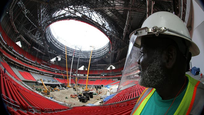 William Griffin works inside Mercedes-Benz Stadium in Atlanta. The stadium is the future home of the Atlanta Falcons football team and the Atlanta United soccer team.