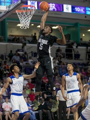 Emmitt Williams of Oak Ridge dunks over Jarius Ashlock of John Marshall High School in Richmond, Va., in the Culligan City of Palms Classic on Wednesday, December 20, 2017, in Fort Myers. Most of his points were from dunks.