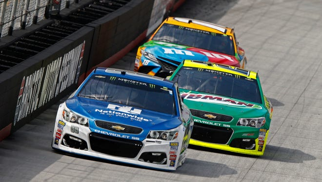 Dale Earnhardt Jr. (88) leads Paul Menard and Kyle Busch during practice Friday.