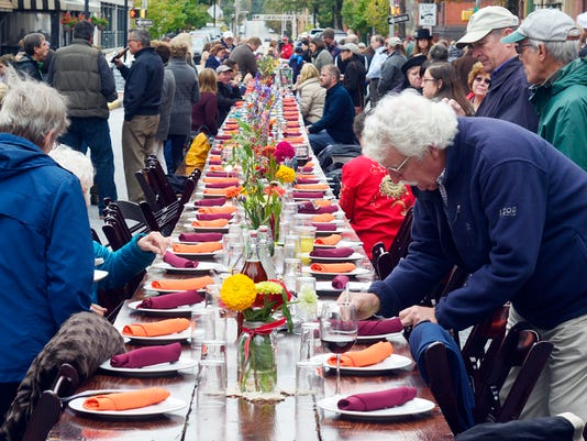 About 200 people gather in the middle of Beaver Street in York for the Farm to City Street Dinner featuring food freshly harvested from local farms, Sunday October 4, 2015. John A. Pavoncello - jpavoncello@yorkdispatch.com