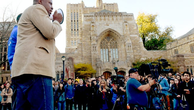 """New Haven Alder Darryl Brackeen, Jr., a community organizer who started the petition to defend New Haven's Status as a sanctuary city for undocumented immigrants, calls on all Yale University students to join together and declare Yale as a """"Sanctuary Campus"""" protecting undocumented immigrant college students during a rally at Yale's Cross Campus, Wednesday, Nov. 16, 2016, in New Haven, Conn. College students at campuses around the United States marched and rallied Wednesday, urging administrators to protect students and employees against immigration action under a Donald Trump presidency. (Peter Hvizdak /New Haven Register via AP)"""