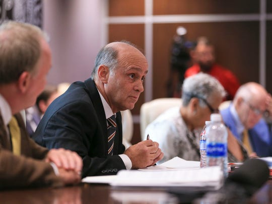 Keith Sherman, board member at the UofL Foundation, brings up a financial matter that former UofL president James Ramsey's name was still attached during a meeting Wednesday, June 14.