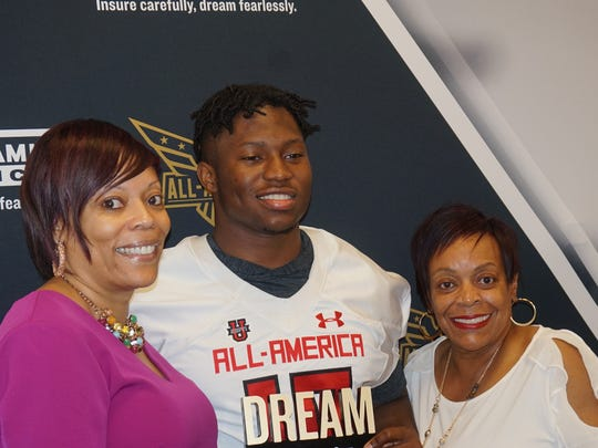 Noah Cain presented his mother, Tonya Cain, with the Dream Champion Award. (Photo: Intersport)