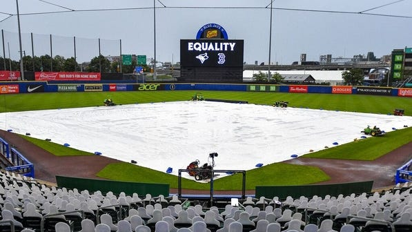 """The scoreboard read """"Equality"""" as rain forced the infield at Sahlen Field to be covered in Buffalo, N.Y., where Thursday's schedule game between the Red Sox and Toronto Blue Jays was postponed in solidarity with other pro leagues."""