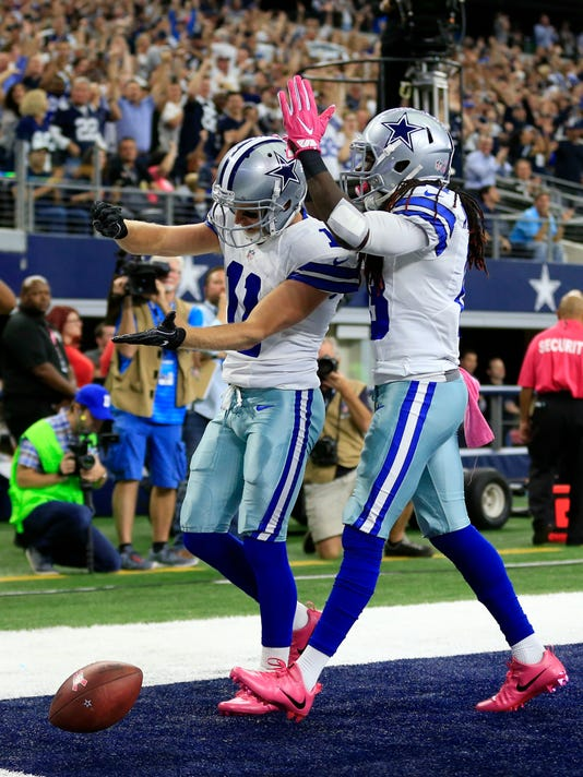 Dallas Cowboys wide receiver Cole Beasley (11) and wide receiver Lucky Whitehead (13) celebrate a touchdown by Beasley in the first half of an NFL football game against the Cincinnati Bengals on Sunday, Oct. 9, 2016, in Arlington, Texas. (AP Photo/Ron Jenkins)