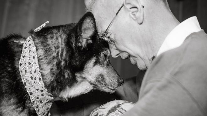 Rescued pet Marcie with her owner Bill Baker.