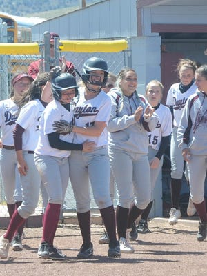 Dayton players celebrate their first win of the season last Saturday against Sparks. It was the first win since 2014 for the DustDevils, who won two of the three-game series.