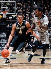 Vanderbilt Commodores guard Wade Baldwin IV (4) drives to the basket against Purdue Boilermakers guard Johnny Hill (1) at Mackey Arena.