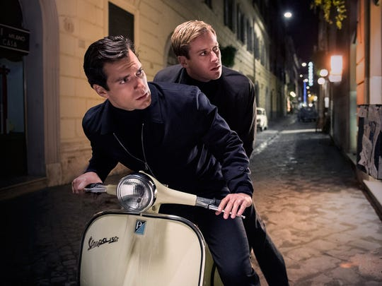"""Henry Cavill stars as Napoleon Solo and Armie Hammer is Illya Kuryakin in """"The Man from U.N.C.L.E."""""""