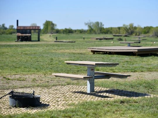 Picnic tables and tent platforms at the Buffalo Camp campground on the American Prairie Reserve.