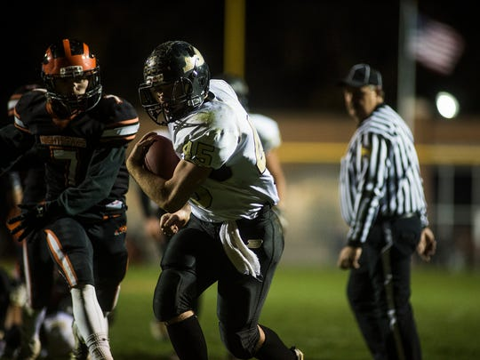 Biglerville Colton Sentz carries the ball through Hanover defense Friday night Nov. 13, 2015 to reach the endzone for a touchdown in the second half at Sheppard-Myers Stadium in Hanover.